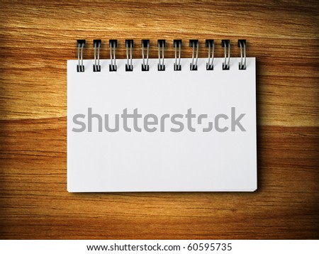 white blank note paper on rubber wood background