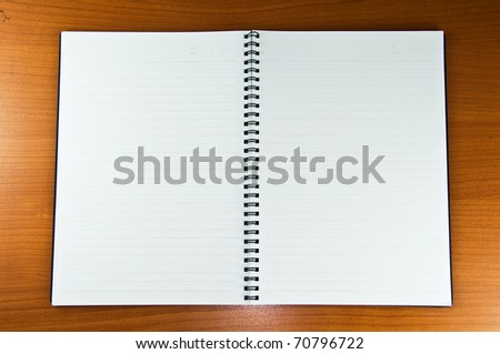 White Blank Notebook on Wood Background