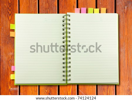 White blank page note book on wood table horizontal