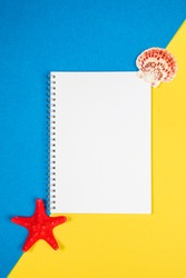 White blank page with star fish and seashell on a blue and yellow background