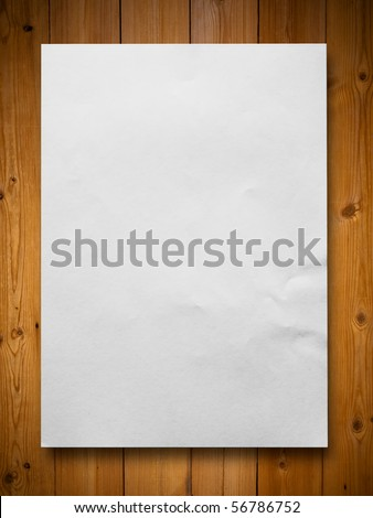 White blank paper on wood background