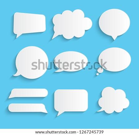 White blank retro speech bubbles set on blue background.  Illustration