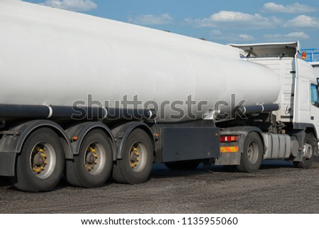 white blank tank truck, rear view, one object on road