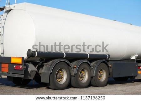 white blank tank truck, rear view, one object on road