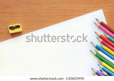White blank with pencils on a wooden table