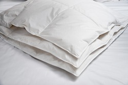 White blanket (quilt) on the bed