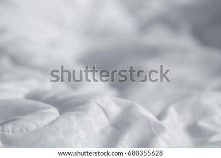 White blanket. Wrinkle messy blanket  in bedroom after waking up in the morning. Bed details. Duvet and blanket, an unmade bed in hotel bedroom with white blanket. Messy White Bed. #680355628