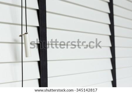 white blinds on window, design interior of bedroom in modern house