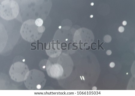 White blue Colorful blurred bokeh lights background. Abstract sparkles particle moving small large defocus different crystal plan overlay blend screen modes, copy space for text logo #1066105034