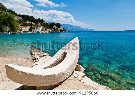White Boat on the Beach and Azure Mediterranean Sea near Split, Croatia