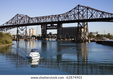 White Boat under Chicago Skyway Bridge. - stock photo