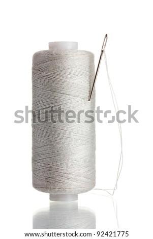 White bobbin with needle isolated on white