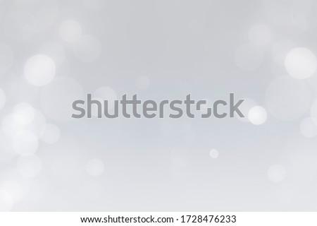 white bokeh defocus glitter blur on gray background. bokeh abstract background.