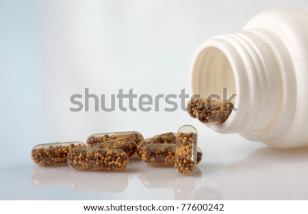 white bottle and capsules