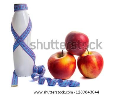 white bottle of yogurt wrapped in blue tape measure in centimete Stock fotó ©