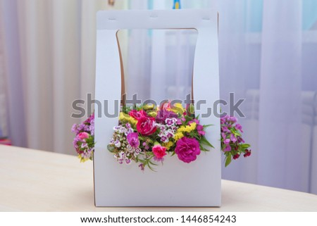 White bouquet of fresh red Pink, white , yellow roses  . White bouquet of multicolored roses . Red white , yellow flower picture close up in the bouquet.