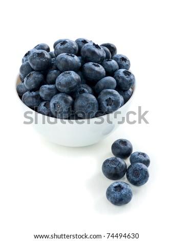 White bowl full of fresh blueberries. Shallow dof.