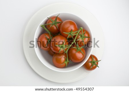 White bowl full of vine tomatoes