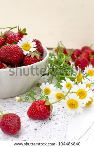 White bowl with fresh strawberries closeup