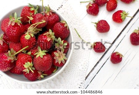 stock photo : White bowl with fresh strawberries closeup