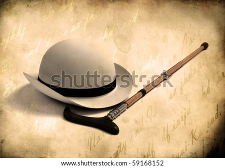 white bowler cap and cane