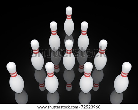 White bowling pins isolated on black.