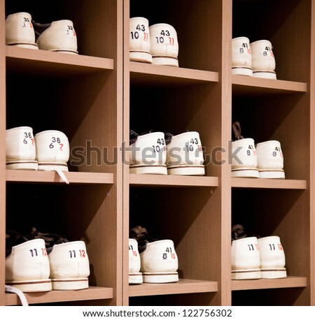 White bowling shoes on racks