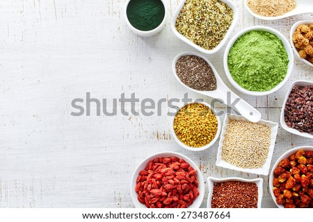 White bowls of various superfoods on white wooden  background Stock photo ©
