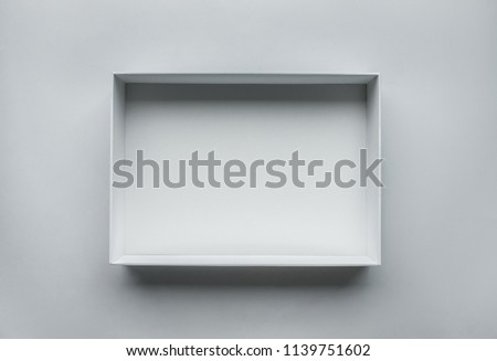 White box open on table.top view.real photo,still life