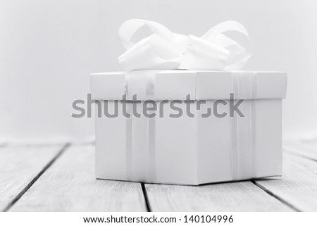White box with a gift in a stylized white