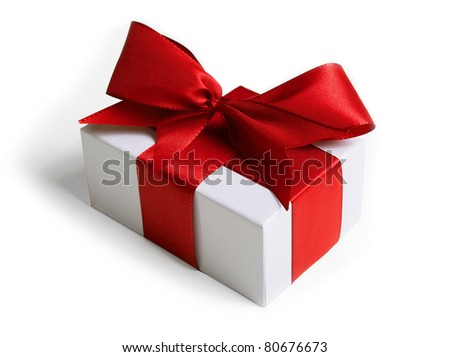 White box wrapped in a red ribbon and bow (with shadow) on white background.
