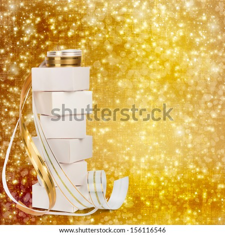 White boxes with gifts with gold ribbon beautiful abstract background