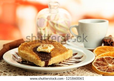 White bread toast with chocolate and cup of coffee in cafe