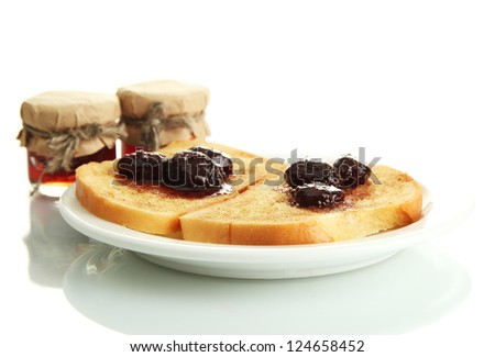 White bread toast with jam on plate, isolated on white