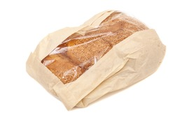 White bread with sesame in a paper bag isolated on white background