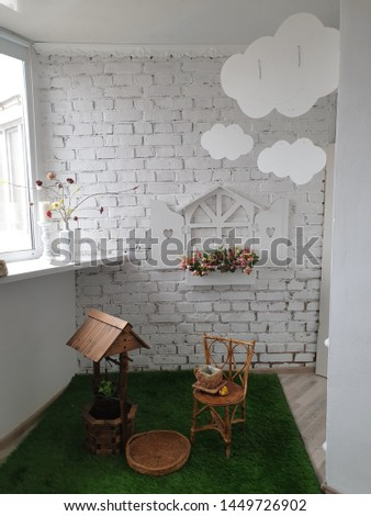 white brick artificial grass and wooden decor well and decor clouds in the decor room #1449726902