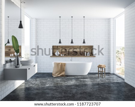 White brick bathroom interior with a concrete floor, a white bathtub, a round sink, several ceiling lamps and a wooden shelf with candles. 3d rendering