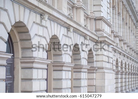 White brick facade with columns in perspective. The building of the Koenigsberg Stock Exchange, Kaliningrad, Russia