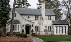 White brick house in rural suburban neighborhood. North Carolina, South Carolina, architecture