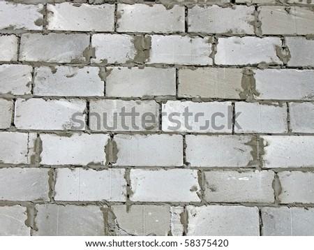 white brick textured wall. concrete connection, construction background details concept