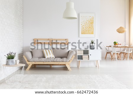 White brick wall and wooden furniture in  apartment #662472436