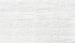 White brick wall background. Neutral texture of a brick wall close-up.