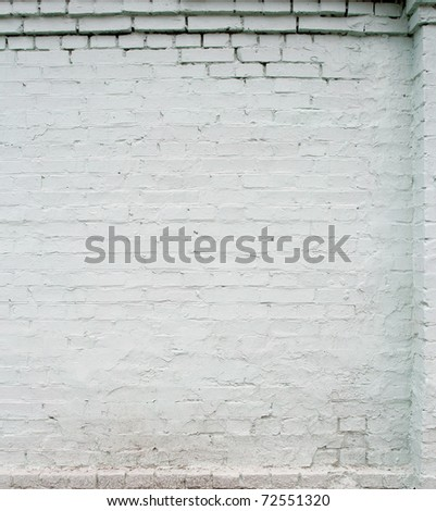 white brick wall, close up, with stucco