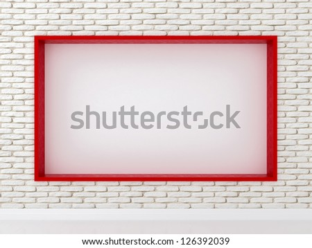White brick wall in the interior with a red frame in the middle