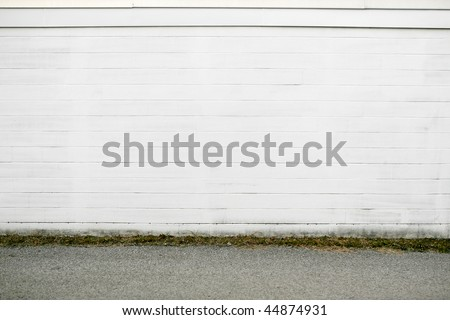 white brick wall pavement