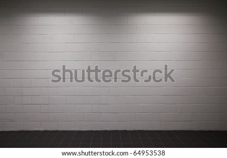 white brick wall pavement with dim lighting