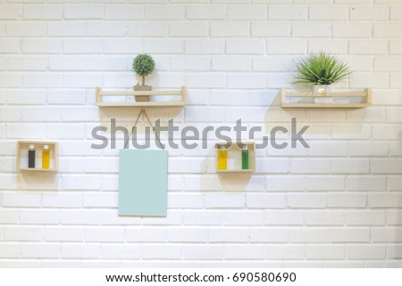 white brick wall with green plant