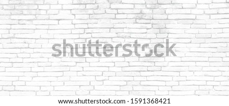 White brick walls that are not plastered background and texture. The texture of the brick is white. Background of empty brick basement wall.
