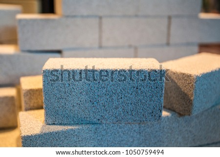 White bricks. The wall is made of porous bricks. Foam concrete. Wall of foam concrete. Construction of aerated concrete.