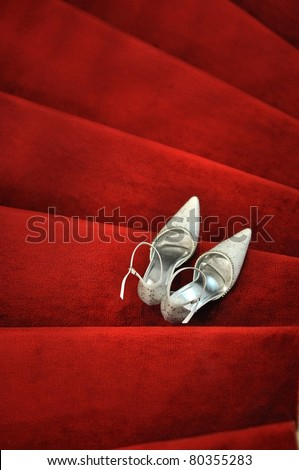 White bridal shoes on red carpet